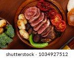 fresh roast bbq beef meat... | Shutterstock . vector #1034927512