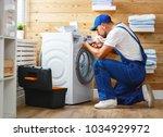 working man plumber repairs a... | Shutterstock . vector #1034929972