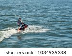 young man on jet ski | Shutterstock . vector #1034939338