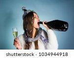 drunk woman drinks champagne... | Shutterstock . vector #1034944918