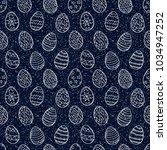 easter eggs pattern. spring... | Shutterstock .eps vector #1034947252