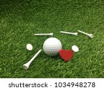 golf ball with tee and marker... | Shutterstock . vector #1034948278