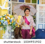 editorial use only  thai lady... | Shutterstock . vector #1034951932