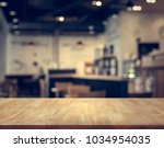 wood table top with blur of...   Shutterstock . vector #1034954035