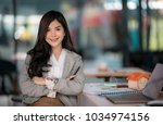portrait of young businesswoman ... | Shutterstock . vector #1034974156