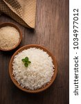 cooked plain white basmati rice ... | Shutterstock . vector #1034977012