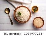 cooked plain white basmati rice ... | Shutterstock . vector #1034977285