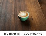 latte with wood background | Shutterstock . vector #1034982448