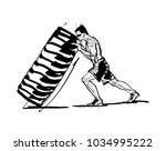 the athlete flips a tire | Shutterstock .eps vector #1034995222