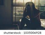 depressed women sitting head in ...   Shutterstock . vector #1035006928
