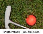 orange golf ball and putter on... | Shutterstock . vector #1035016336