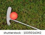 orange golf ball and putter on... | Shutterstock . vector #1035016342