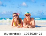 couple on a tropical beach at... | Shutterstock . vector #1035028426