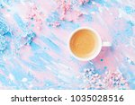 cup of coffee and flowers on... | Shutterstock . vector #1035028516