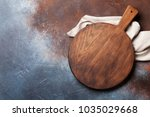 cutting board over metal table... | Shutterstock . vector #1035029668