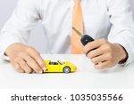 businessman holding a car keys...   Shutterstock . vector #1035035566