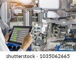 industry 4.0 robot concept ... | Shutterstock . vector #1035062665