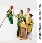 indian family celebrating gudi... | Shutterstock . vector #1035074782