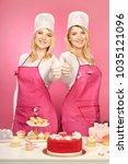 nice blonde twins baking cakes... | Shutterstock . vector #1035121096