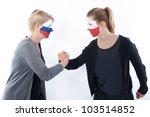 Football soccer fans arm wrestling - stock photo