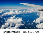 blue sky and clouds below from... | Shutterstock . vector #1035178726