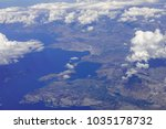 blue sky and clouds below from... | Shutterstock . vector #1035178732