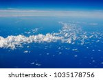 blue sky and clouds below from... | Shutterstock . vector #1035178756