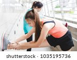 sportswomen stretching after... | Shutterstock . vector #1035195736