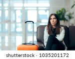 bored woman with suitcase in... | Shutterstock . vector #1035201172