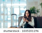 woman reading phone messages in ... | Shutterstock . vector #1035201196