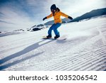 snowboarder snowboarding in... | Shutterstock . vector #1035206542