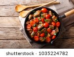 veal in spicy sauce with cherry ... | Shutterstock . vector #1035224782