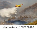 A Yellow Canadair Or Water...