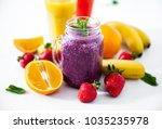 blueberry smoothies on a white... | Shutterstock . vector #1035235978