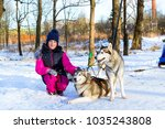 girl playing with siberian... | Shutterstock . vector #1035243808