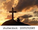 man before the cross  praying... | Shutterstock . vector #1035252085