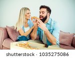 hungry modern young couple... | Shutterstock . vector #1035275086