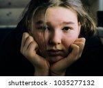 sad girl teenager close up... | Shutterstock . vector #1035277132
