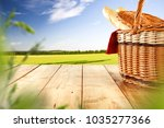 picnic basket on table and... | Shutterstock . vector #1035277366