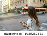 close up on woman hands holding ... | Shutterstock . vector #1035282562