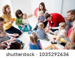 young moms with their kids | Shutterstock . vector #1035292636