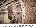 japanese yen banknotes and... | Shutterstock . vector #1035299866