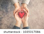 man and woman hands together... | Shutterstock . vector #1035317086