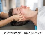 physiotherapist  chiropractor... | Shutterstock . vector #1035337495