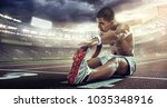 sport. runner stretching on the ... | Shutterstock . vector #1035348916