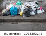 road and footpath full of... | Shutterstock . vector #1035353248
