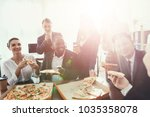 the office staff eat pizza and... | Shutterstock . vector #1035358078