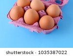 top view of six brown eggs on... | Shutterstock . vector #1035387022