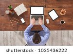 man is working on the their... | Shutterstock . vector #1035436222