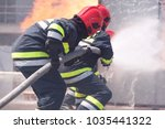 firefighters in action.... | Shutterstock . vector #1035441322
